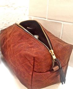 wax canvas toiletry bag by NASH & DUFF on Etsy, £21.00