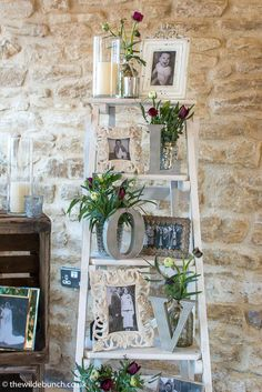 Wedding venue styling by Bristol Florists, The Wilde Bunch at Kingscote Barn. An old ladder & a few crates makes a perfect Rustic setting for the family pictures that are always a focal point for guests at any wedding. To see loads more Wilde Bunch designs at Kingscote Barn click here http://www.thewildebunch.co.uk/#/kingscote-barn/4593454423