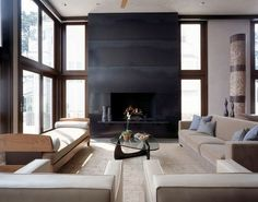 Because the fireplace has windows on either side it integrates easily into the design