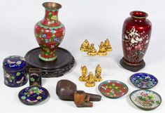 Lot 204: Decorative Asian Object Assortment; Including cloisonne vase, dishes, match box holder and a covered jar, a Meerschaum pipe head in a case and resin deity figures