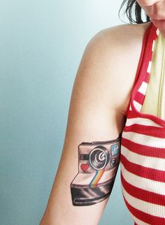Pretties camera tattoo ever.