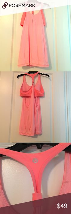Lululemon Top Pink and coral lululemon workout/yoga top! Perfect for yoga, the gym, or lounging. Lulu size 10 which fits like a large! Built in bra for support. (Cut off tags due to discomfort). lululemon athletica Tops Tank Tops