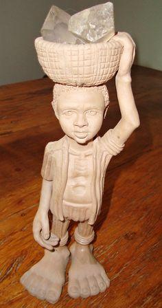 Beto Pezão, menino com balaio na cabeça, cerâmica. Reproduçao fotográfica Blog Fufuquices.