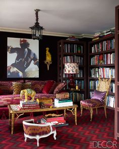 """For 20 years I wanted velvet walls. Now I have them in the library,"" Alex Papachristidis says. In that same room, the windows are draped in satin curtains, the étagères are overlaid in wool felt, the lampshades are trimmed in batik tablecloths, and the sofa is covered in nine different fabrics and studded with exuberant tassels along the base."