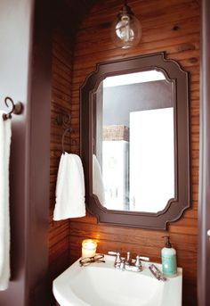Bathroom Alcove, ditch the brown trim, maybe go with pine, but keep the white towels, light and washstand