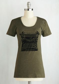 On the Write Track Top. Whether youre an aspiring novelist, an avid journaler, or simply a fan of prose, you can appreciate the screenprinted vintage typewriter on this olive-green tee! #green #modcloth
