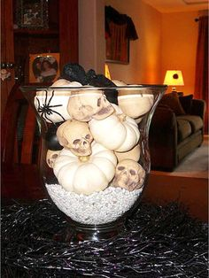 Festive Halloween 2007 from tlbhatcher Why we picked this: We can't get enough of these small, white pumpkins and tiny skulls in a clear vase. Adding elements of black in the centerpiece really makes the white objects pop.