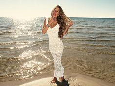 Handmade crochet wedding dress WHITE. LOVE. and goes to a great cause!