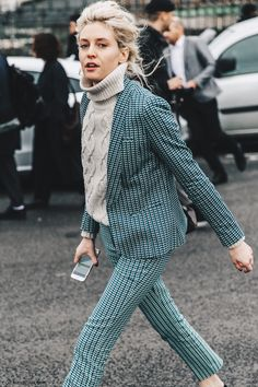 cable knit turtleneck, green checkered blazer and trousers