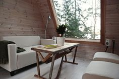 """Built overlooking a lake in Finland, this Micro Cabin, nicknamed """"Nido,"""" was designed and built by Robin Falck to enjoy once out of the military. It took a"""