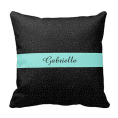 An elegant black on black leopard print throw pillow with an aqua stripe. This preppy and chic animal pattern can be personalized by adding the name of a modern woman.
