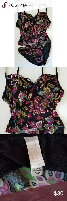 GORGEOUS! ? VS TANKINI! Victorias Secret Tankini in beautiful matte black with vibrant floral print. Shoulder straps and sweet center tie. Top is a 34 D and Bottoms (M) are brief (like) with nice coverage. Victoria's Secret Swim
