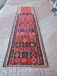 Awesome ebay kilim.  Will someone please buy?  Too big for our house, love the colors.  $269