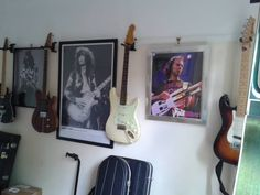 Picture Rail Guitar Hangers in use, easy to use no mess no fuss.