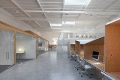 lovely ply+white, nooks to hide in and white decking.  Hybrid Office by Edward Ogosta Architecture