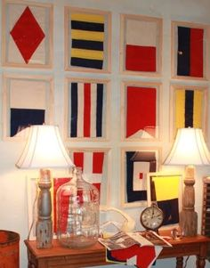 This is made out of vintage nautical flags but wouldn't it be fun to reproduce this with nautical scrapbook paper :D. Wall outside of master Nautical Flags, Nautical Design, Nautical Home, Vintage Nautical Decor, Nautical Colors, Vintage Flag, Nautical Nursery, Coastal Living, Coastal Decor