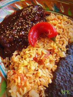 Chicken Mole, Mexican Red Rice and Refried Black Beans. Hispanic Kitchen