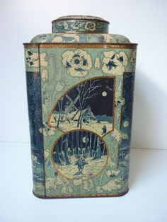 Dutch tea tin in blue and white, decorated with winter scenes and poppy flowers, rectangular w/ rounded corners, slightly rounded top rising to cap lid, c. 1900