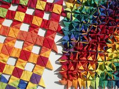 A cool origami quilt found on flickr. Fabric folding by Louise Mabbs.