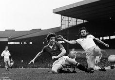 27th November 1976. Manchester United winger Gordon Hill slides in to challenge West Ham United defender Frank Lampard at Upton Park.
