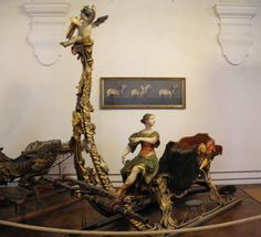 The Marstallmuseum, at Schloss Nymphenburg, houses a collection of royal carriages and sleighs in what were once the royal stables. There are coronation coaches, state coaches and sleighs, all highly gilded and ornamented as well as lavishly decorated harnesses and paintings of favoured horses.