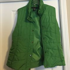 Green Puffer Vest Green Puffer Vest. 100% Polyester. Zip up with fastener's. Small water stain on front as identified in picture. ( have to be close up to see it) New York & Company Jackets & Coats Vests