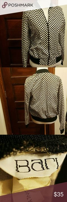 Start Your Engines! 1980s Bari Bomber Jacket! B&W checkered bomber jacket from the 1980s! Tag says size M, best fit a modern S. Pockets! This is a vintage peice and the white has faded to give uniform ombre appearance. Small seam separation on the left shoulder that is not visable with the bold pattern when worn. Pair with leggings or jeans and you will be sure to turn heads at the finish line! Vintage Jackets & Coats Utility Jackets