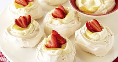 These delightful lemon and cream meringues are topped with fresh sweet strawberry slices.