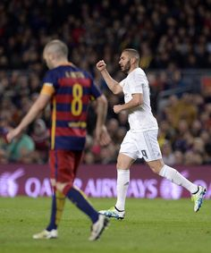 "Real Madrid's French forward Karim Benzema celebrates a goal during the Spanish league ""Clasico"" football match FC Barcelona vs Real Madrid CF at the Camp Nou stadium in Barcelona on April 2, 2016."