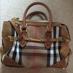 """BURBERRY PRORSUM Strapped Boston Bag Gorgeous iconic Nova Check canvas satchel with camel leather straps and sueded top, sides and bottom. Reinforced leather handles drop 7"""". Gold tone hardware and """"feet"""". Zip top. Front Burberry logo plate.  Comes with detachable long cross-body strap. Canvas lined with inner storage pockets trimmed in leather. Comes with dust bag. Excellent like new condition. Awesome statement bag! Burberry Bags Satchels"""