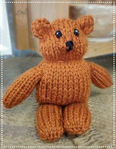 Garter Stitch Teddy Bear - 100% Acrylic yarn, polyester stuffing.  Embroidered face. :-)