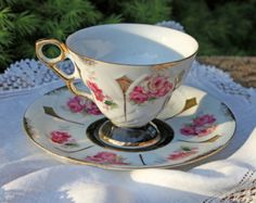 Vintage Teacup with Saucer. Footed Tea cup