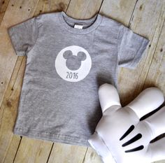 This is for a shirt or onsie with a circle with Mickey Head / Mickey Ears with 2016 under it. The Head and 2016 is transparent.  Who doesnt want an awesome customized shirt for Disney? You took time planning this crazy trip, so why not plan a fantabulous wardrobe? *********************************************************************************************  Please let me know if you have any issues at all and I will be happy to assist you…