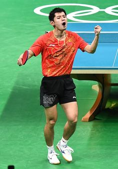 Zhang Jike of China celebrates a point against Jeoung Youngsik of South Korea…