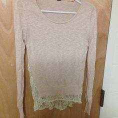 Long sleeve shirt Beautiful long sleeve shirt with half the back full of lace. Small rip on the top near the shoulder. Tops Blouses