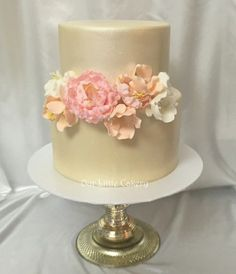 Elegant 2 tier wedding cake with champagn shimmer and blush sugar flowers