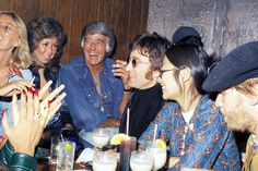 john lennon, may pang, harry nilsson, and peter lawford at the troubador for the smothers brothers reunion show prior to being thrown out for drunken outbursts during john's los angeles lost weekend phase 1974 by gsjansen, via Flickr