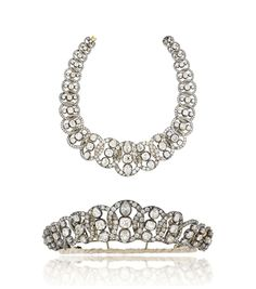 A magnificent mid-19th century diamond tiara / necklace | Composed of a series of interlocking old-cut diamond-set graduated loops, each with a pear and cushion shaped diamond three stone centre, mounted in silver and gold, circa 1860