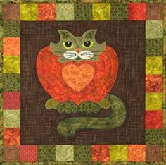 """This is block seventeen of the popular StoryQuilt series, Garden Patch Cats by Helene Knott. The quilt block finishes at 18"""" square. Take a break from quilting for a taste of the Persimmon Coffee Cake"""