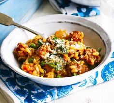 Tomato & chorizo risotto - A truly easy weeknight dinner, this rice dish is like a simple paella or jambalaya - add broad beans or sweetcorn for extra colour Chorizo Recipes, Pasta Recipes, Dinner Recipes, Baked Risotto Recipes, Rice Recipes, Chorizo Rice, Prawn And Chorizo Risotto, Gourmet, Lunches