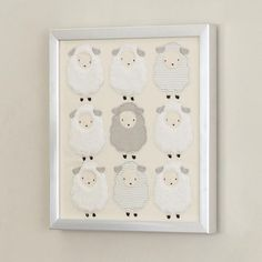 """Our furry little sheep decorate this stunning wall decor complete with a silver metallic frame. Measures 15"""" long x 15"""" wide. Saw tooth hangers are attached to the back for easy hanging."""