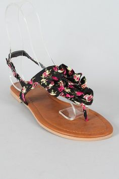 Black and floral thong sandals with ruffles.