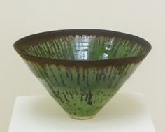 LUCIE RIE (1902-1995). Green conical bowl with manganese rim, 1960's, porcelain.
