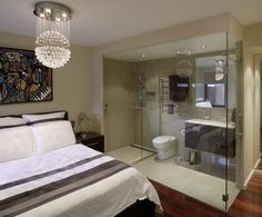 Ensuite bathroom completley glass-in within the bedroom. Not sure I would  like someone