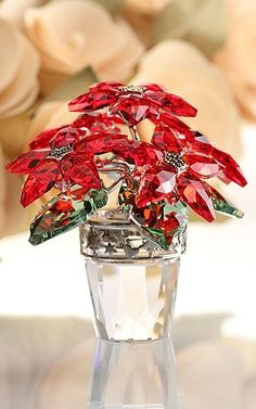 The traditional Christmas colors of Light Siam and Peridot crystal sparkle on this magnificent Poinsettia .How beautiful! Swarovski Crystal Figurines, Swarovski Jewelry, Swarovski Crystals, Cut Glass, Glass Art, Glass Figurines, Crystal Collection, Christmas Colors, Christmas Tables