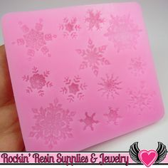 Snowflakes Silicone Mold Snowflakes silicone mold featuring 13 snowflake cavities made from food safe material and can be used with so many mediums from chocolate and fondant to polymer clay and resin