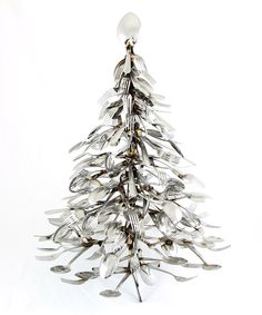 Christmas tree was crafted using stainless steel utensils for a cool eclectic vibe. make your own for under 250.00!!!!