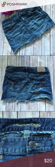"""American Eagle Distressed Denim Skirt American Eagle distressed denim skirt. Frayed bottom hem. There's an intentional hole in the middle of the skirt (see last photo). Length is approx. 12"""", waist is approx. 15"""" when measured laying flat. Super cute!!!  🚫NO TRADES 🚫NO OFF SITE  ✅POSH RULES ONLY ✅DOG FRIENDLY, SMOKE FREE HOME ✅FAIR OFFERS 🔵 PLEASE USE OFFER BUTTON!  ❓ASK IN THE COMMENTS!   🔹🔹🔹BUNDLE 2+ ITEMS & SAVE!!!!!🔹🔹🔹 American Eagle Outfitters Skirts"""