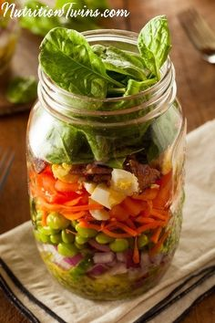 Superfood Mason Jar Salad with Lemon Vinaigrette   Perfect Healthy Meal when on the Go   Doesn't Get Soggy   Satisfying with 30 Grams Protein   For MORE RECIPES, fitness & nutrition tips please SIGN UP for our FREE NEWSLETTER www.NutritionTwins.com