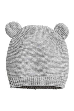 7e12a59f77c Hat in soft cotton fabric with attached ears at top.